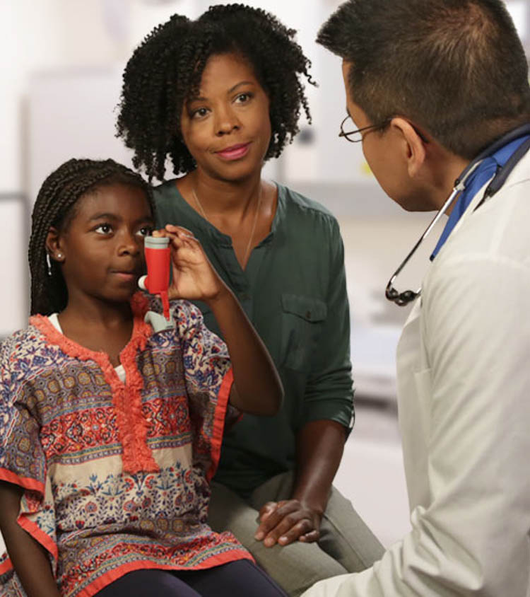 African American asthma patient with a doctor