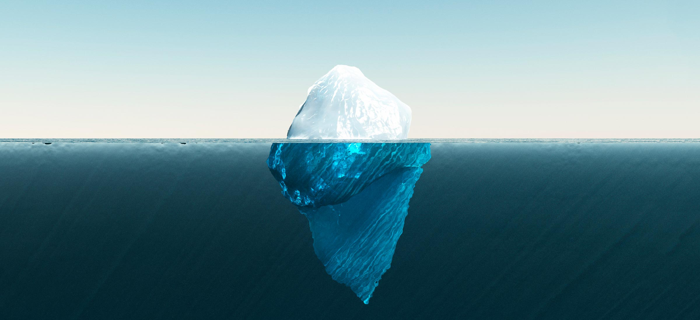Photo of an iceberg showing above and below water level